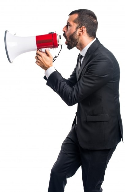 Businessman shouting on a megaphone