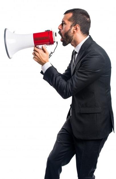 Businessman shouting on a megaphone
